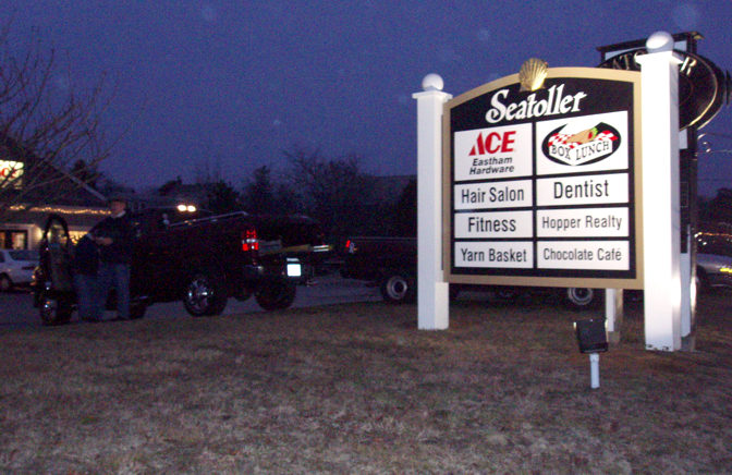 Seatoller Shoppes with lights at night.